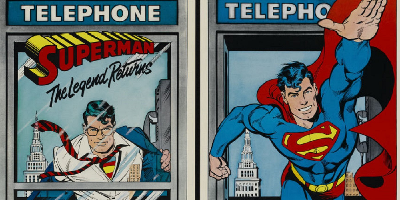 Superman changing in a phone booth